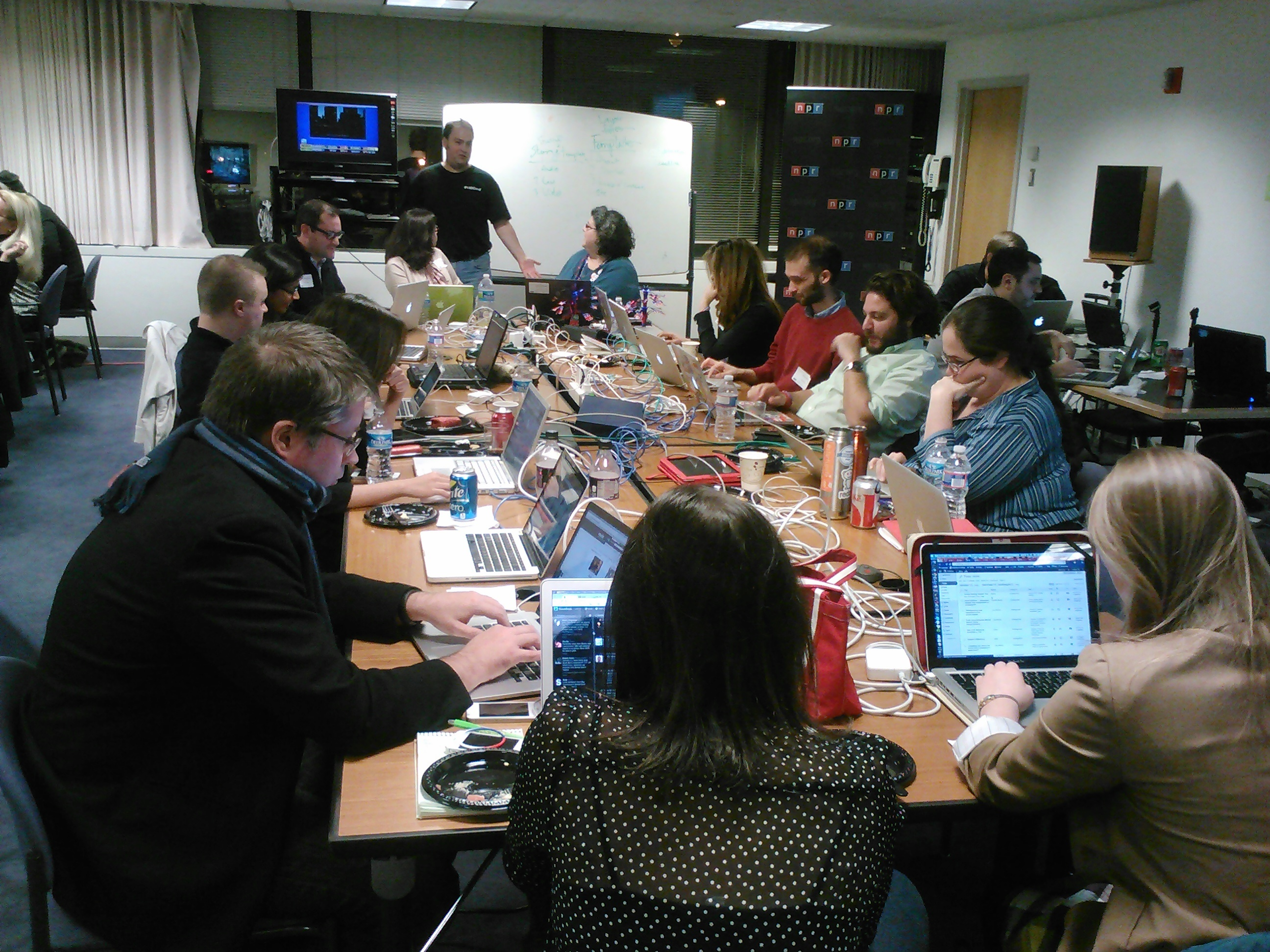 Inside NPR headquarters in Washington on election night. NPR senior strategist Andy Carvin stands in the back of the room. (Photo by Jolie Lee)