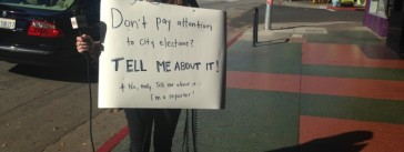 KPCC reporter Meghan McCarty canvasses the streets of Los Angeles with a sandwich board and a microphone. (KPCC photo)