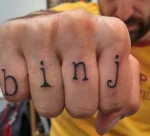 "Chris Faraone is so serious about the Boston Institute for Nonprofit Journalism that he's tattooed the acronym ""binj"" on his knuckles."